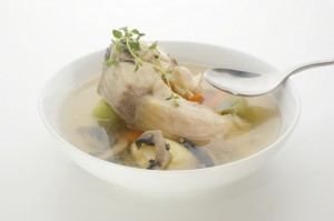 carp fish soup with fresh organic herbs